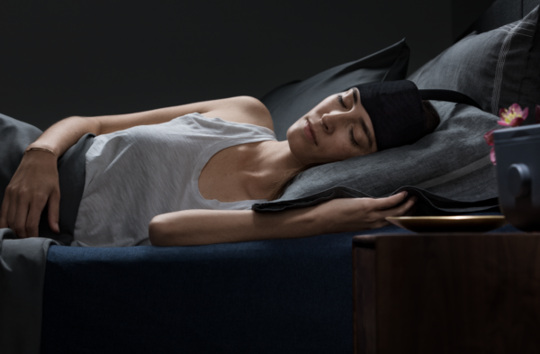 woman sleeping using Ebb Insomnia Therapy